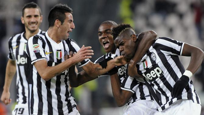 Juventus' Pogba celebrates with teammates Ogbonna and Isla after scoring against Napoli during Italian Serie A match in Turin