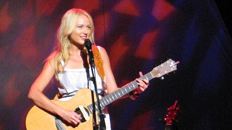 Jewel rocks the guitar.