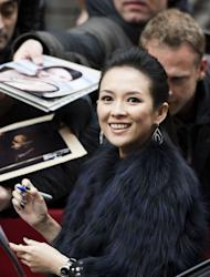 Chinese actress Zhang Ziyi gives autographs to her fans as she arrives for a photocall and a press conference for the film Yi dai zong shi (The Grandmaster) in Berlin, February 7, 2013. The 63rd Berlin film festival opens with a gala screening of Chinese director Wong Kar Wai's martial arts epic about the mentor of kung fu superstar Bruce Lee