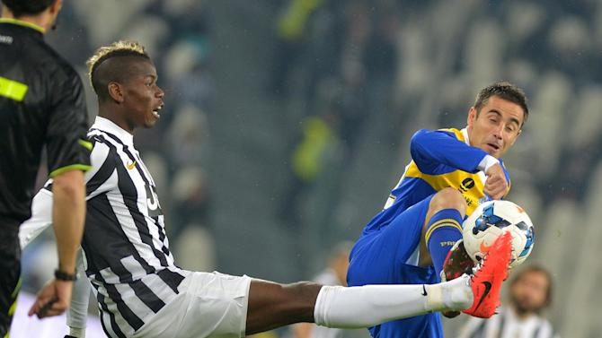 Juventus midfielder Paul Pogba, of France, left,  vies for the ball with Parma midfielder Marco Marchionni during a Serie A soccer match between Juventus and Parma at the Juventus stadium, in Turin, Italy, Wednesday, March 26, 2014