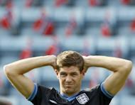 England captain Steven Gerrard stretches during a training session on the eve of a friendly match against Norway at the Ullevaal stadium in Oslo. England are hoping to exploit the feel-good factor created by Manchester City and Chelsea triumphs at home and abroad as a new era under Roy Hodgson kicks off against Norway