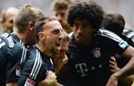 (From L) Bayern Munich's Franck Ribery, Philipp Lahm and Dante celebrate after scoring a goal during a Bundesliga match in M'gladbach, western Germany, on May 18, 2013. The all-German Champions League final between Borussia Dortmund and Bayern on Saturday marks the culmination of an intensifying and increasingly bitter rivalry