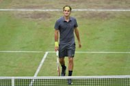 Switzerland's Roger Federer walks to the net after defeating Russia's Mikhail Youzhny in their semi-final at the ATP Gerry Weber Open in Halle, western Germany. Federer will face Germany's Tommy Haas in the final at Halle after both won their semi-finals