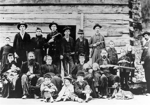 The Hatfield clan poses in April 1897 at a logging camp in southern West Virginia. The most infamous feud in American folklore, the long-running battle between the Hatfields and McCoys, may be partly explained by a rare, disease inherited by the McCoy clan that can lead to hair-trigger rage and violent outbursts.(AP Photo)
