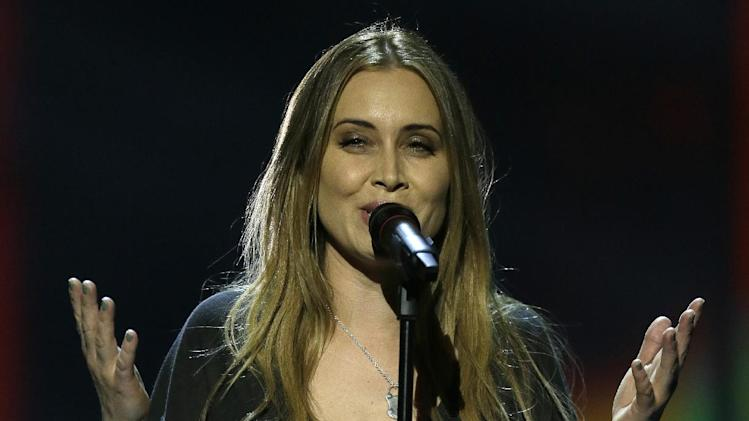 Anouk of the Netherlands performs her song Birds during the final of the Eurovision Song Contest at the Malmo Arena in Malmo, Sweden, Saturday, May  18, 2013. The contest is run by European television broadcasters with the event being held in Sweden as they won the competition in 2012. (AP Photo/Alastair Grant)