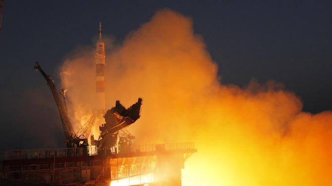 The Soyuz-FG rocket booster with Soyuz TMA-07M space ship transporting U.S. astronaut Thomas Marshburn, Russian cosmonaut Roman Romanenko and Canadian astronaut Chris Hadfield to the International Space Station blasts off from the Russian leased Baikonur cosmodrome, Kazakhstan, Wednesday, Dec. 19, 2012. (AP Photo/Dmitry Lovetsky)