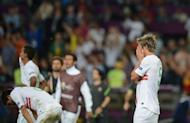 Portugal defender Fabio Coentrao reacts after his side lost a penalty shootout 4-2 to Spain in the Euro 2012 semi-final at the Donbass Arena in Donetsk, Ukraine