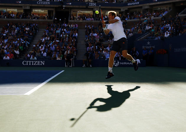 Britain's Andy Murray hits a return to Serbia's Novak Djokovic during the men's singles final match at the U.S. Open tennis tournament in New York