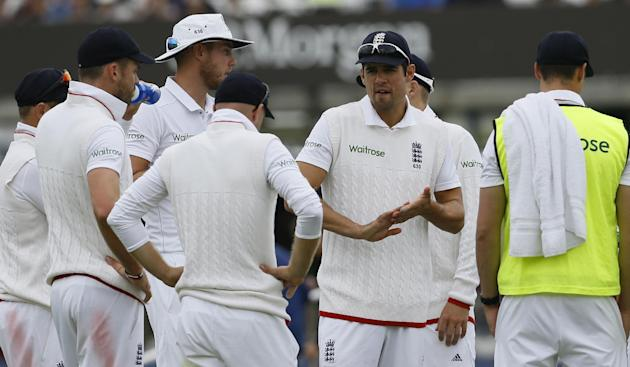 England's captain Alastair Cook, second right talks to his team during a drinks break during play on the second day of the first Test match at Lord's cricket ground in London, Friday, May 22,