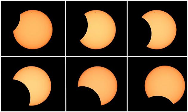 The moon is pictured crossing in front of the sun (clockwise, top L) as seen from the Sydney Observatory on May 10, 2013