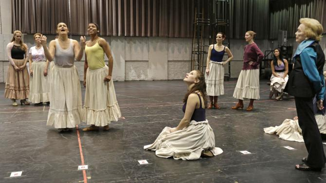 "In this April 26, 2013 photo, choreographer Gemze de Lappe, right, oversees a rehearsal of Rodgers and Hammerstein's ""Oklahoma!"" at the Lyric Opera of Chicago. De Lappe first danced in ""Oklahoma!"" in 1943 as a member of the Broadway hit's first national touring company and now 70 years later at age 91 she's choreographing a production of the musical at the Lyric. (AP Photo/M. Spencer Green)"