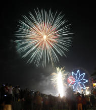 Thousands of revelers troop to the capital's largest shopping mall to watch the fireworks display to welcome the New Year Sunday Jan.1, 2012 in Manila, Philippines. (AP Photo/Bullit Marquez)