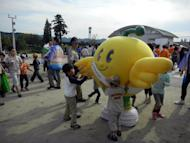 "This handout picture taken by Fukushima prefectural government on October 14, 2012 shows children playing with a grinning bird mascot ""Kibitan"" in Fukushima, northern Japan. Children in Fukushima are getting fatter as outdoor activities have been cut in the area due to radiation fears after last year's nuclear disaster, a Japanese government report said Tuesday"