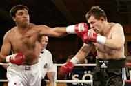 Corrie Sanders of South Africa (left) hits Russia's Alexei Varakin during an international boxing Eurofight in Soelden, Austria in 2004. Sanders died of wounds sustained in a shooting at a Pretoria restaurant where he was celebrating his daughter's 21st birthday