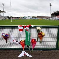 Flowers are laid at Ravenhill Ground in memory of Nevin Spence, who died on Saturday