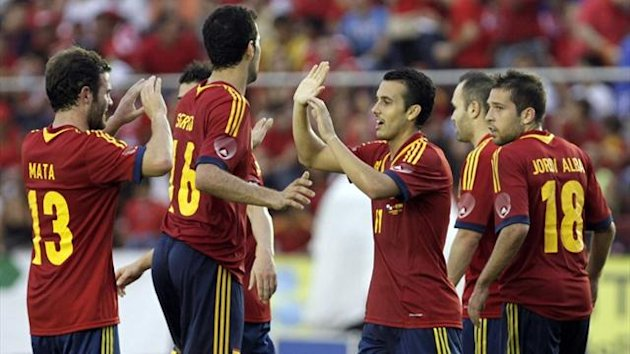 Spain's Pedro celebrates with team-mates after scoring his second against Panama (Reuters)
