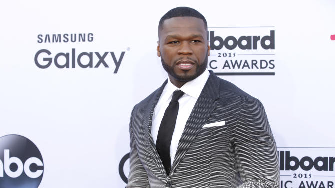 "FILE - In this May 17, 2015 file photo, 50 Cent arrives at the Billboard Music Awards at the MGM Grand Garden Arena in Las Vegas. Someone else's sex tape is proving to be costly for 50 Cent: A jury ordered the rapper-actor Friday, July 10, 2015, to pay $5 million to a woman who said he acquired a video she made with her boyfriend, added himself as a crude commentator and posted it online without her permission. Born Curtis Jackson, 50 Cent burst to the fore of gangsta rap with 2003's ""Get Rich or Die Tryin,'"" its lead single, ""In Da Club,"" and a tough life story that included having been shot nine times. (Photo by Eric Jamison/Invision/AP, File)"