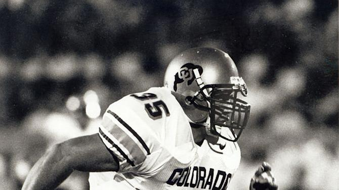 "In this undated photo provided by the University of Colorado, Keith Miller rushes down the field as a fullback for the NCAA college football team. Miller has reinvented himself, going from the gridiron to the stage and will appear in Verdi's ""Un Ballo in Maschera,"" at the Metropolitan Opera in New York. Performances begin Thursday, Nov. 8, 2012. (AP Photo/University of Colorado)"