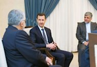 "A handout picture released by SANA on September 1, 2013 shows Syrian President Bashar al-Assad (C) meeting with Iranian Aladin Borujerdi (L) in Damascus. Assad warned Monday that Western military strikes would risk igniting a ""regional war"" in the ""powder keg"" of the Middle East, in an interview with French newspaper Le Figaro"