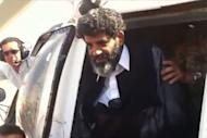 A handout video grab taken from footage shot by a member of Libyan security forces shows Abdullah al-Senussi, a former spy of late Libyan leader Moamer Kadhafi, arriving at the high security prison facility in Tripoli