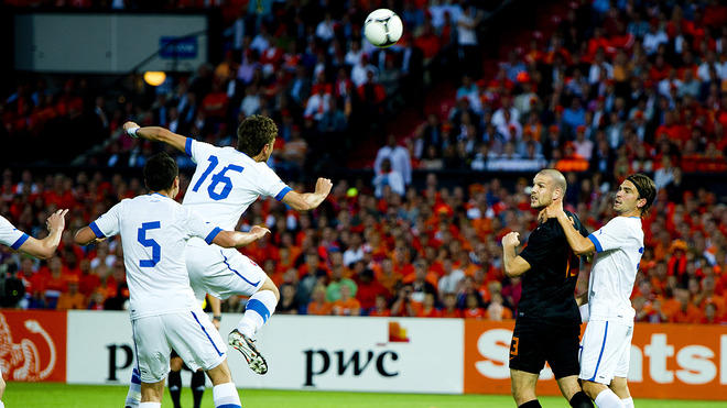 Netherlands' Stijn Schaars (2nd R) Vies For The Ball With Players Of The Slovak Team      ROBIN UTRECHT/AFP/ AFP/Getty Images