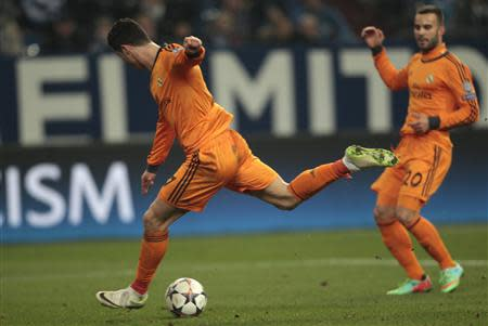 Real Madrid's Cristiano Ronaldo scores a goal against Schalke 04 during their Champions League soccer match in Gelsenkirchen