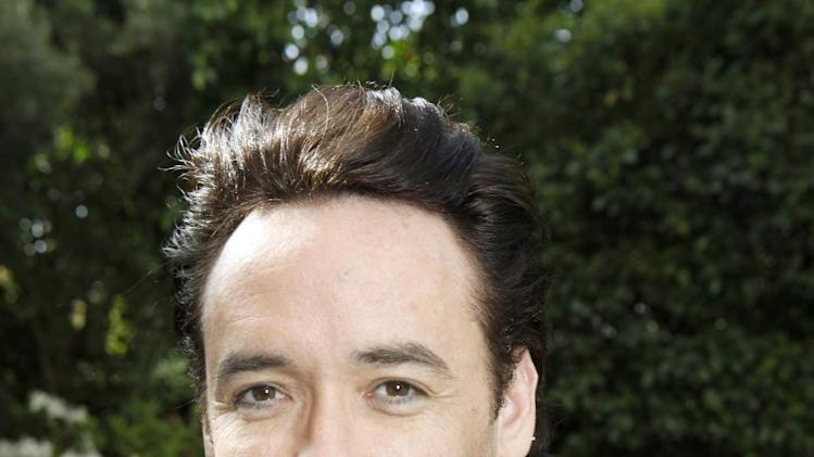 FILE - In this March 20, 2010 file photo, actor John Cusack poses for a portrait in Los Angeles.  Director Betty Thomas said Cusack's production company has a script ready that will star the actor as Limbaugh in 2013. It's not typecasting: Cusack is an outspoken liberal. (AP Photo/Reed Saxon, File)