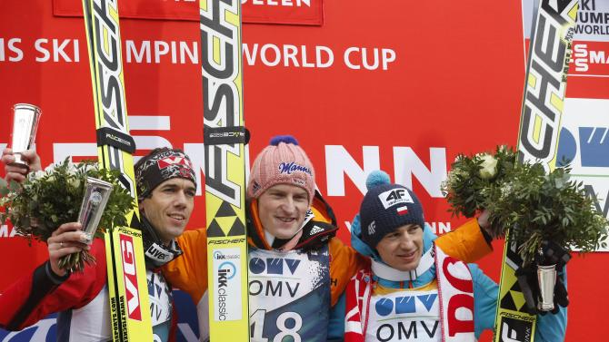 Bardal, Freund and Stoch pose after completing their jumps in the World Cup ski jumping large hill individual event in Oslo