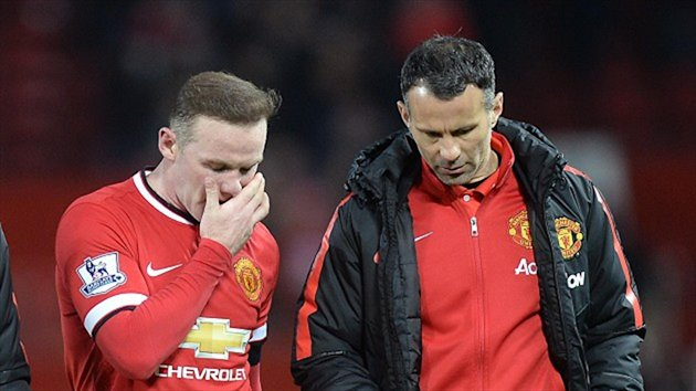Rooney, left, talking with assistant manager Ryan Giggs following United's disappointing FA Cup exit on Monday