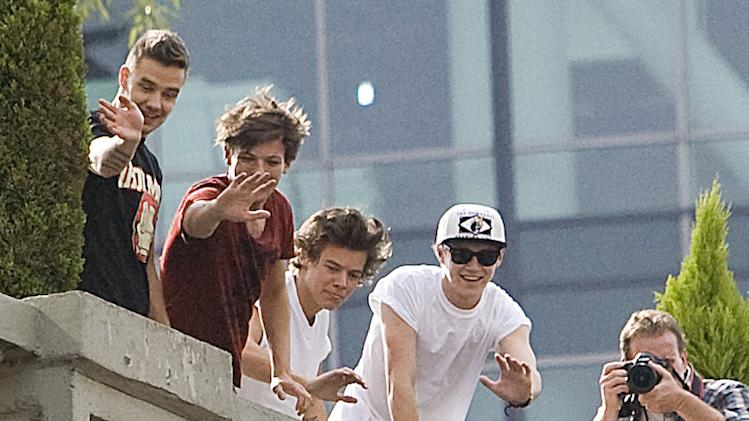 British group One Direction say Hola to fans at their hotel in Mexico City