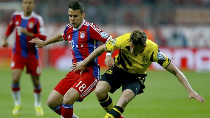 Bayern Munich's Bernat challenges Borussia Dortmund's Durm during German Cup semi-final soccer match in Munich