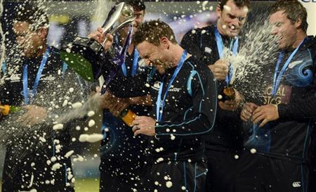 New Zealand's McCullum holds the series trophy as champagne flies after the third one-day international cricket match against England at Trent Bridge cricket ground in Nottingham