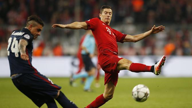 Bayern Munich's Robert Lewandowski in action with Atletico Madrid's Jose Gimenez