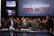 """France's opposition Socialist Party (PS) candidate for the 2012 presidential election Francois Hollande (C) waits prior to taking part in the TV broadcast show """"Des paroles et des actes"""" on a set of French TV channel France 2. Hollande, facing off against resurgent Nicolas Sarkozy, looked to make up ground Thursday with vows to boost taxes on the rich"""