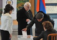 Armenians vote at a polling station in Yerevan, on February 18, 2013. Authorities were hoping for a peaceful process that would improve the country's chances of European integration