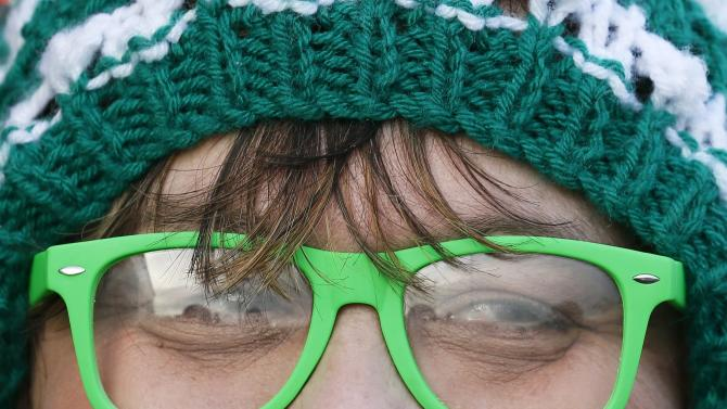 A Yeovil Town fan looks on outside the St Mary's stadium before the English FA Cup fourth round soccer match between Southampton and Yeovil Town in Southampton, southern England