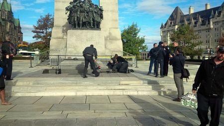 A Canadian soldier who was shot outside the war memorial on Parliament Hill in tended to in Ottawa