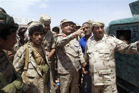 Yemen's Defence Minister Major General Muhammad Nasir Ahmad (2nd R) gestures as he visits Mayfaa, in the southeastern province of Shabwa May 4, 2014 in this handout photo provided by Yemen's defence ministry. Yemen said on Sunday 37 al Qaeda fighters had been killed in heavy clashes between the army and the militants in the southern Shabwa province. REUTERS/Yemen's Defence Ministry/Handout via Reuters