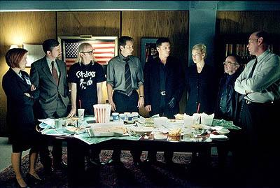 """The forces of good and evil - L-R: Scully (Gillian Anderson), Byers (Bruce Harwood), Langly (Dean Haglund), Mulder (David Duchovny), Krycek (Nicholas Lea), Marita Covarrubias (Laurie Holden), Frohike (Tom Braidwood) and Skinner (Mitch Pileggi) - join together to discuss a case in the """"Requiem"""" episode of Fox's The X-Files X-Files"""