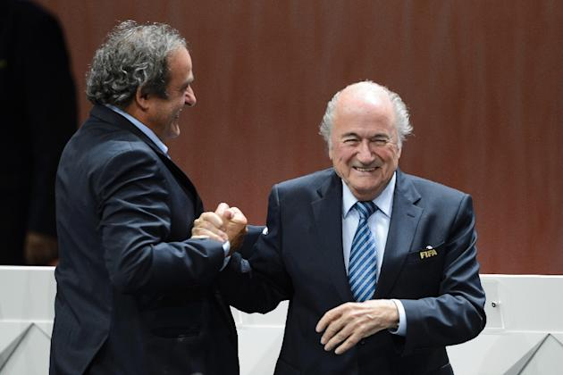 FIFA president Sepp Blatter (R) is congratulated by UEFA President Michel Platini after being re-elected during the FIFA Congress in Zurich on May 29, 2015