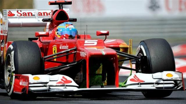Alonso leads way at dry Spa