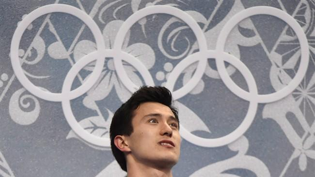 Canada's Patrick Chan waits for his marks for his men's free program in the figure skating competition at the Sochi Winter Olympics Friday, February 14, 2014 in Sochi. Three-time world champion Chan is eager to return after taking a year off. THE CANADIAN PRESS/Paul Chiasson