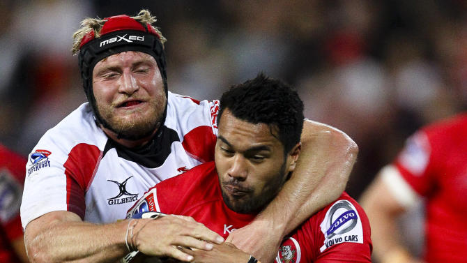 Queensland Reds centre Digby Ioane (R) is tackled by Golden Lions lock Franco Van Der Merwe during their Super 15 rugby union match at Suncorp Stadium in Brisbane on May 19, 2012.  IMAGE STRICTLY RESTRICTED TO EDITORIAL USE - STRICTLY NO COMMERCIAL USE AFP PHOTO / Patrick HamiltonPATRICK HAMILTON/AFP/GettyImages