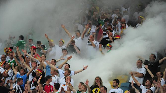 German fans threw screwed-up paper on the pitch in Lviv