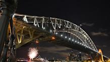 Fireworks go off at the Sydney Harbour Bridge and Opera House to signal the start of Earth Hour