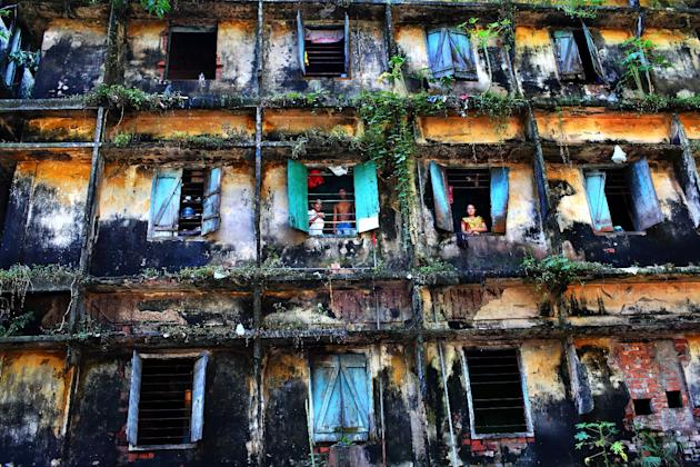 'Survivors' by GMB Akash in Bangladesh. The decrepit building houses eighty families of sweepers, the lowest in the caste system and regarded as 'untouchables'. This picture is one of