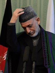 Hamid Karzai addresses a joint press conference with Pakistani prime minister Nawaz Sharif at the Presidential Palace in Kabul on November 30, 2013