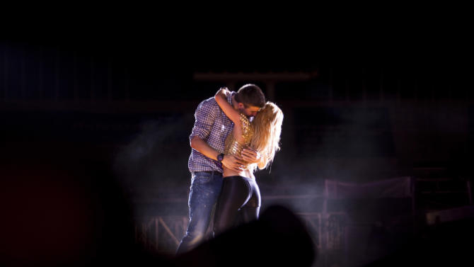 Colombia's star singer Shakira performs with FC Barcelona's Gerard Pique during