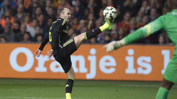 Football - Guus Hiddink 'disgusted' by boos directed at Andres Iniesta