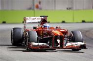 Ferrari Formula One driver Fernando Alonso of Spain drives during the first practice session of the Singapore F1 Grand Prix at the Marina Bay street circuit in Singapore September 20, 2013. REUTERS/Natashia Lee